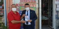 """ÜNSAL """"SOYKIRIM KİTABINI KARADAĞA HEDİYE ETTİ"""