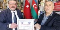 TADDEF'den Gazeteci Ercüment Daşdelen'e Teşekkür belgesi